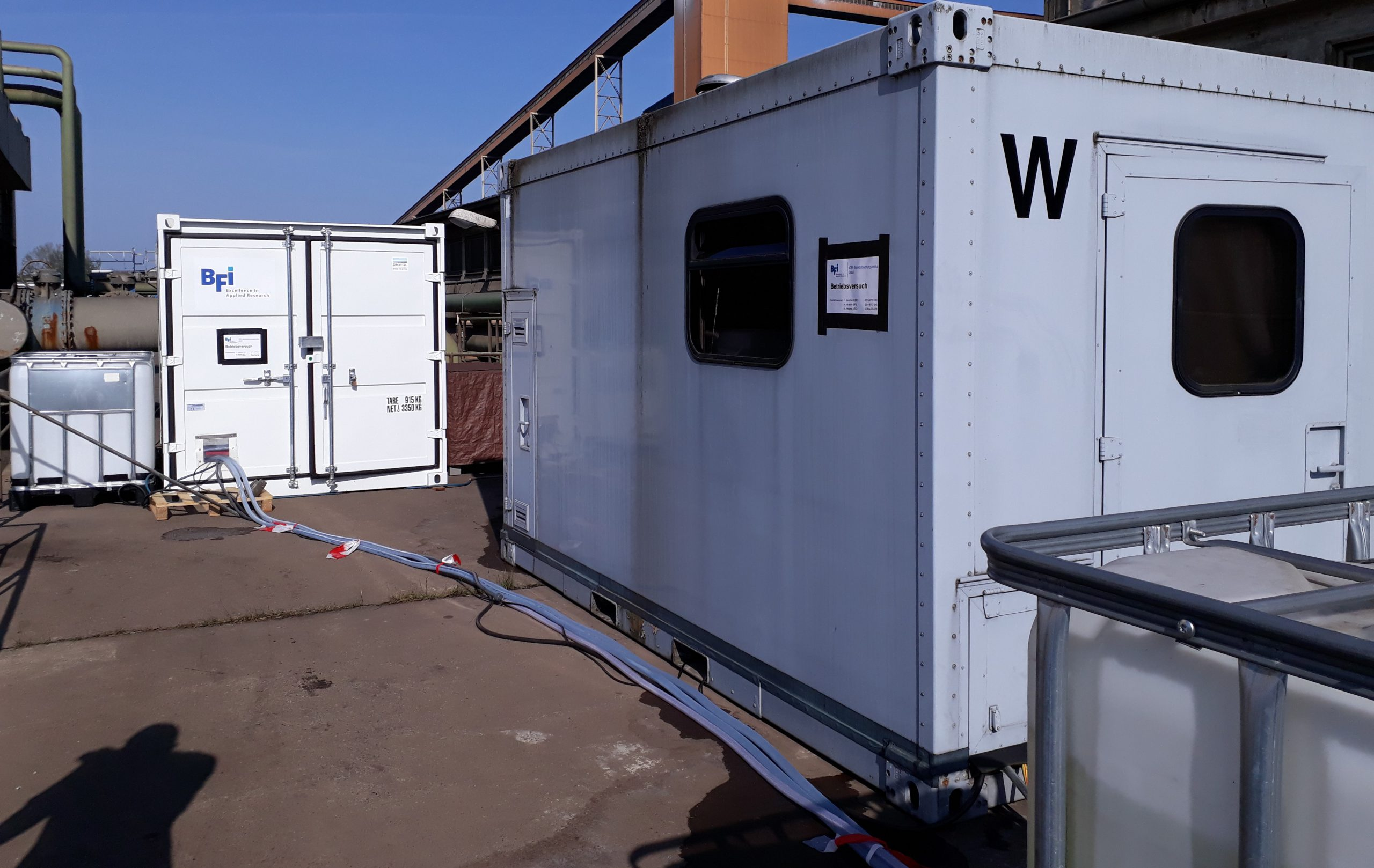 Container with mobile BFI test plant for desalination and laboratory container at a field trial